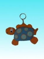 Porte clés dingosaure orange,corps et pois bleus