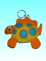 Porte-clés dingosaure orange corps jaune pois bleus
