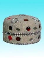 Boîte ronde blanche avec perles