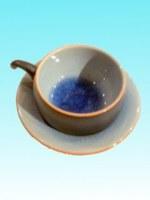 Tasse à café ronde bleue et sous tasse assortie